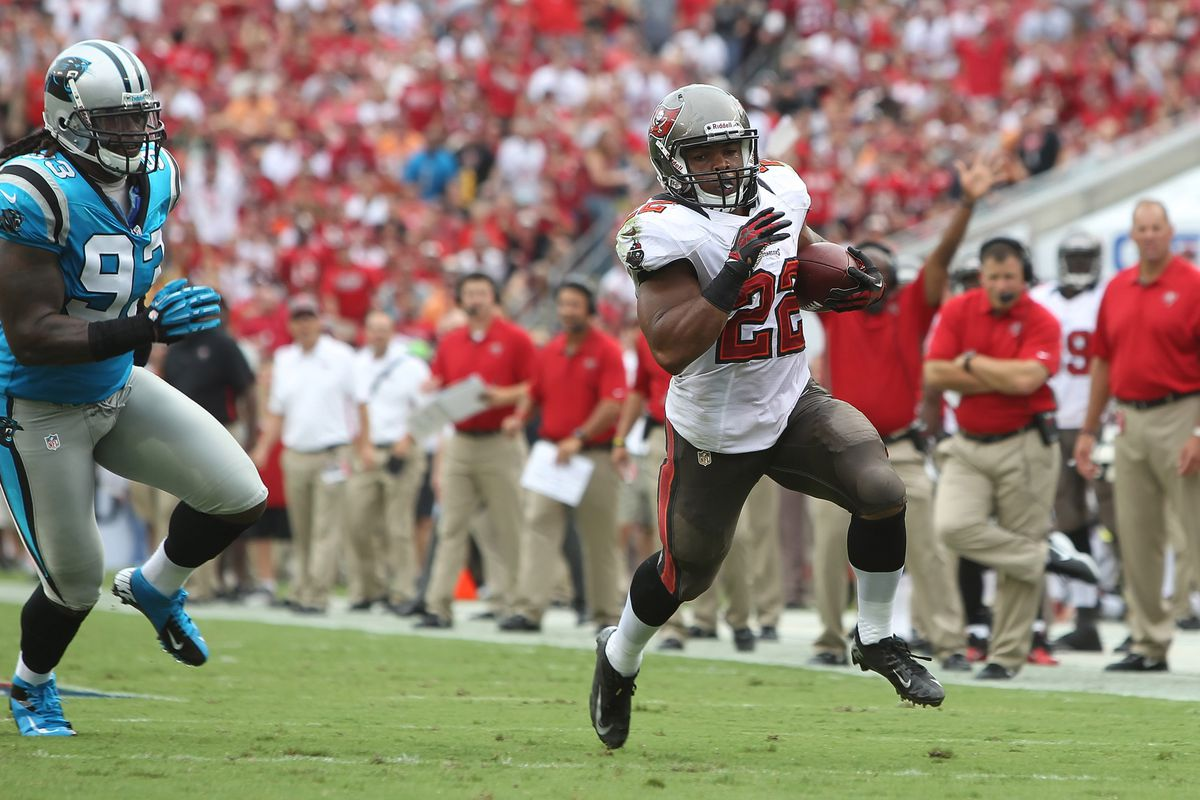 September 9, 2012; Tampa, FL, USA; Tampa Bay Buccaneers running back Doug Martin (22) runs with the ball in the first quarter against the Carolina Panthers at Raymond James Stadium. Mandatory Credit: Kim Klement-US PRESSWIRE