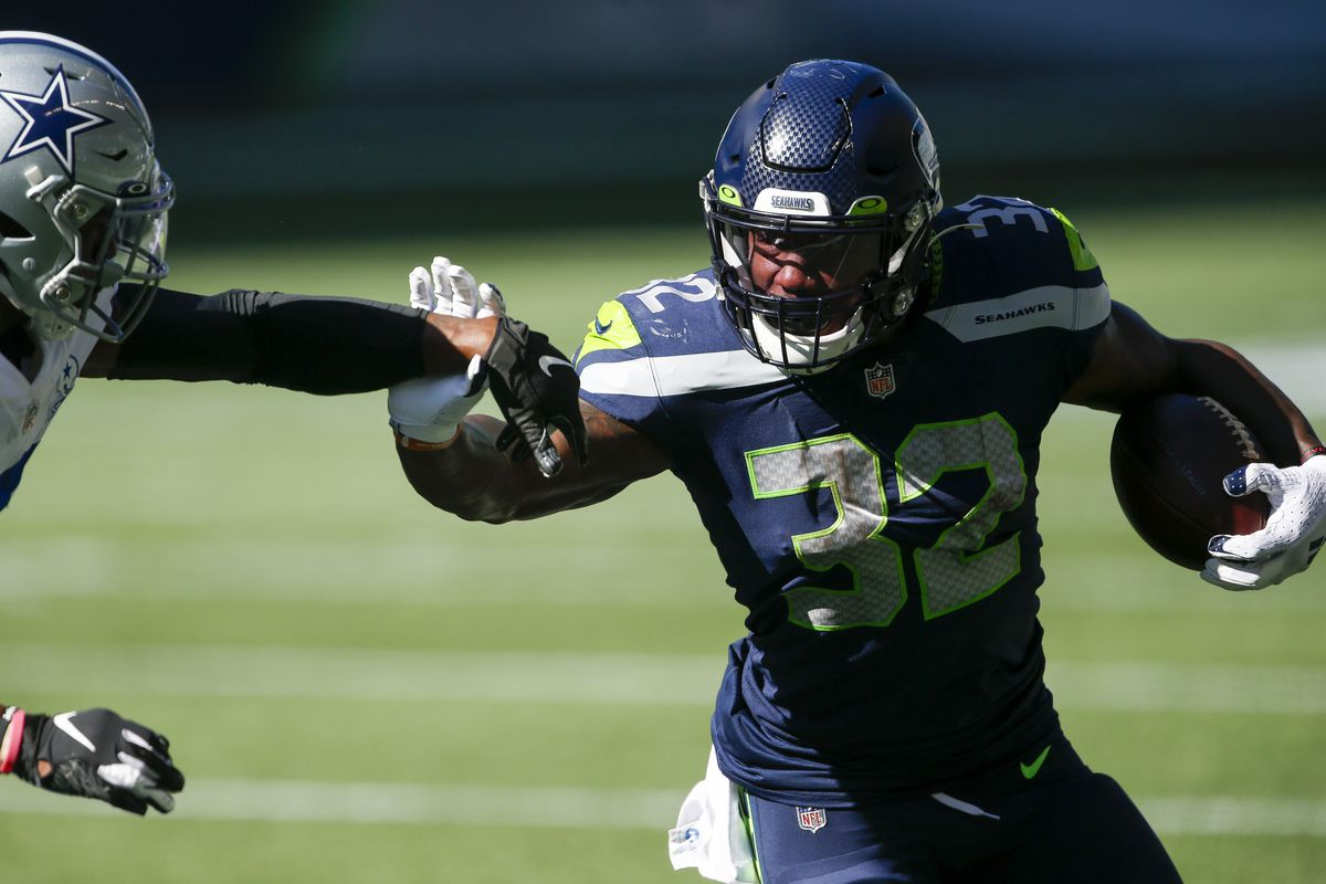 Seattle Seahawks running back Chris Carson rushes against the Dallas Cowboys during the second quarter at CenturyLink Field.