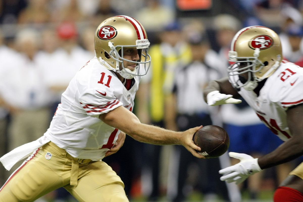 Aug 18, 2012; Houston, TX, USA; San Francisco 49ers quarterback Alex Smith (11) hands the ball off to running back Frank Gore (21) against the Houston Texans in the first quarter at Reliant Stadium. Mandatory Credit: Brett Davis-US PRESSWIRE