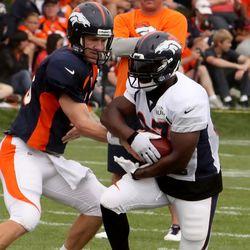 Denver Broncos quarterback Peyton Manning hands off to RB Knowshon Moreno
