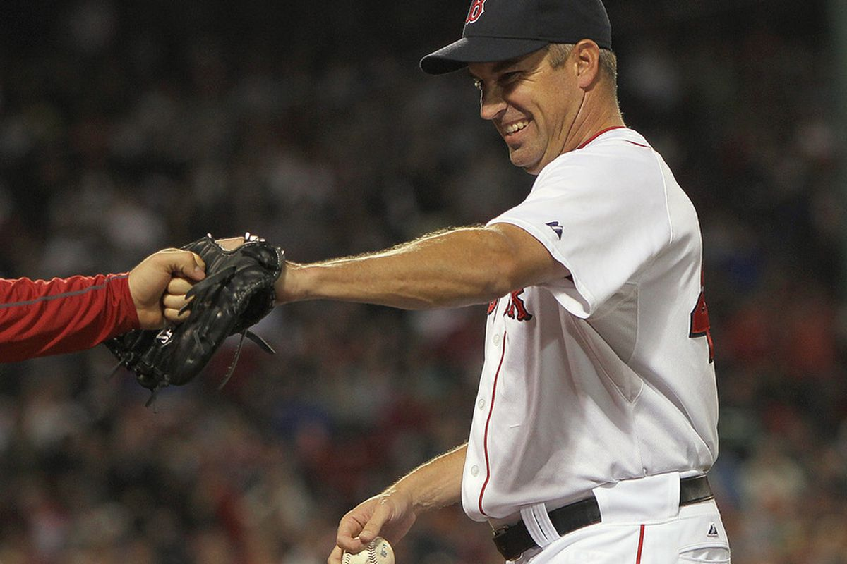 BOSTON, MA - SEPTEMBER 20:  Scott Atchison #48 of the Boston Red Sox smiles as he leaves the field during a game with the Boston Red Sox at Fenway Park September 20, 2011 in Boston, Massachusetts. (Photo by Jim Rogash/Getty Images)