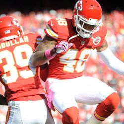 Kansas City Chiefs defensive back Husain Abdullah (39) is congratulated by safety Bradley McDougald (48) after Abdullah scores during the second half of the game against the Oakland Raiders at Arrowhead Stadium. The Chiefs won 24-7.