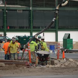 5:37 p.m. Concrete being poured in the triangle lot -