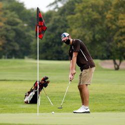 Mount Carmel's Michael Dobrich lines up a putt during practice at Jackson Park Golf Course.