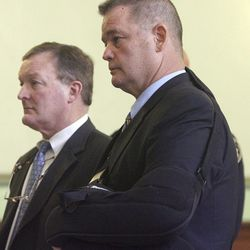 North Providence, R.I., Police Chief Col. John J. Whiting, right, of North Attleboro, Mass., stands with his attorney John Harwood, left, in Providence, R.I., Superior Court for a hearing Monday, April 30, 2012.  Whiting rejected an offer from prosecutors in his larceny and obstruction of justice case. Whiting is accused of stealing hundreds of dollars from the pocketbook of a stripper whose SUV crashed after a high-speed chase last August.