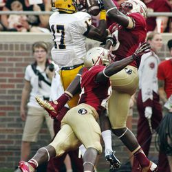 Florida State safety Karlos Williams, top, and Florida State cornerback Xavier Rhodes, bottom, break up a pass to Murray State wide receiver Dontel Watkins (17) in the end zone in the first half of an NCAA college football game, Saturday, Sept. 1, 2012, in Tallahassee, Fla.