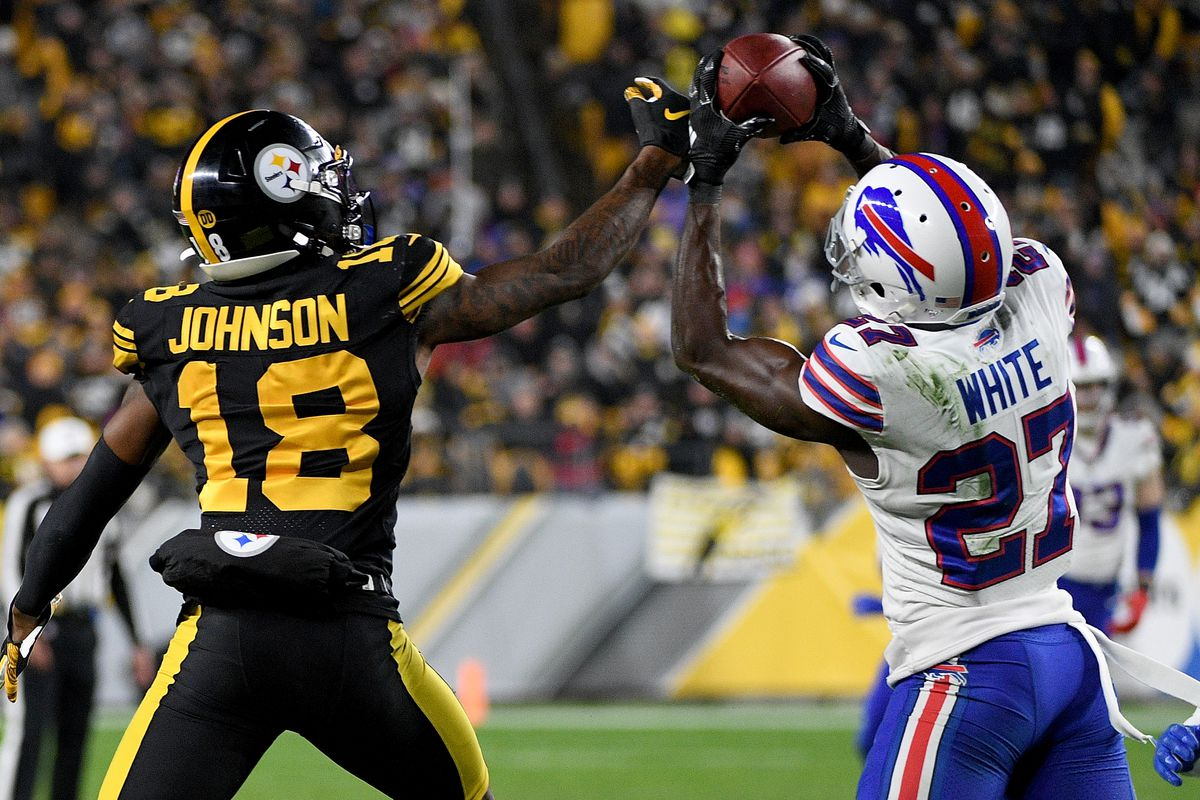 Tre'Davious White of the Buffalo Bills intercepts a pass intended for Diontae Johnson of the Pittsburgh Steelers in the third quarter during the game at Heinz Field on December 15, 2019 in Pittsburgh, Pennsylvania.