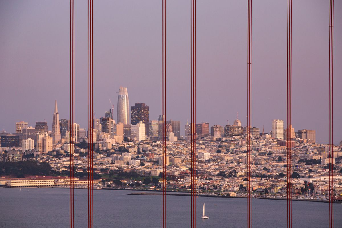 The SF skyline seen through the cables of the Golden Gate Bridge.