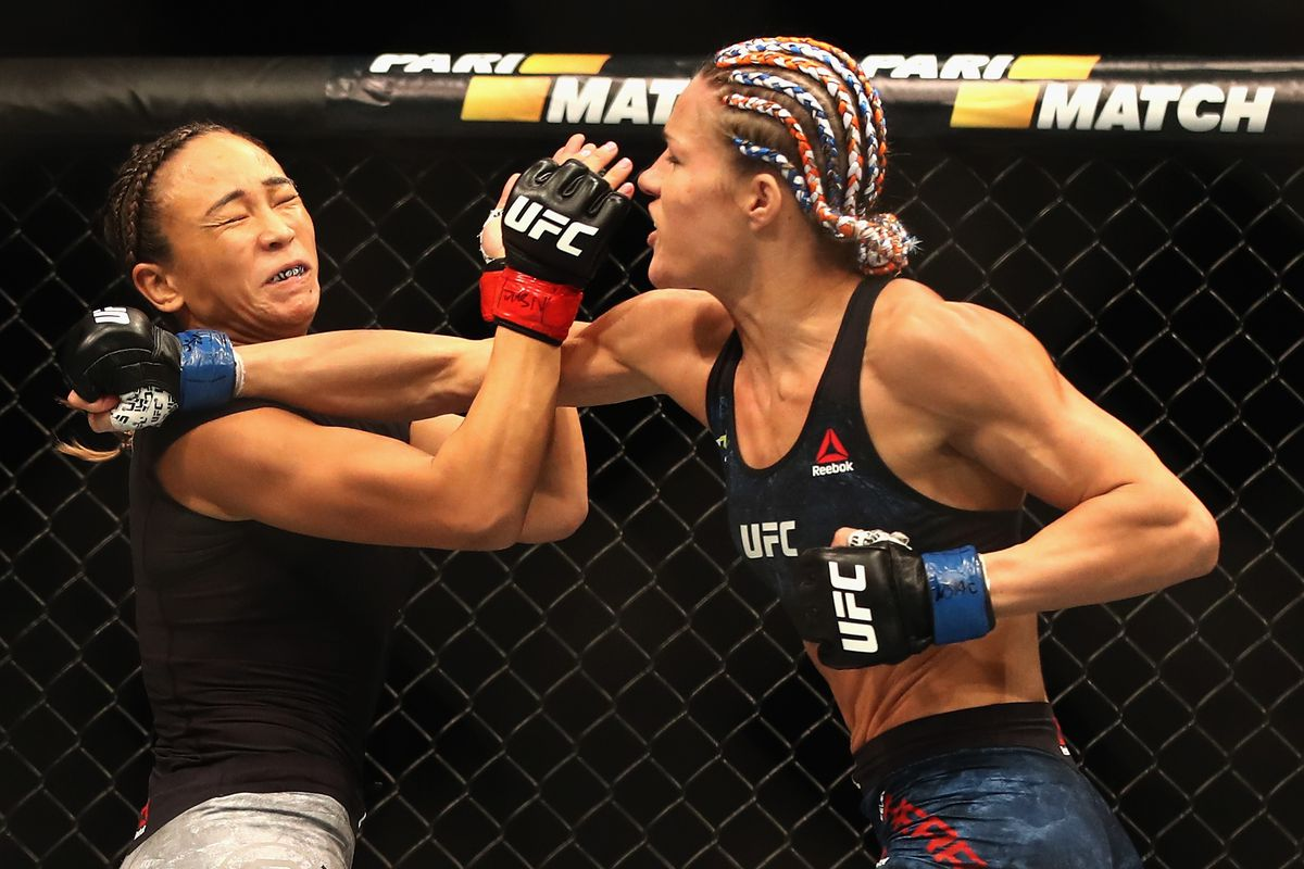 Felice Herrig punches Michelle Waterson in their women's strawweight bout during the UFC 229 event inside T-Mobile Arena on October 6, 2018 in Las Vegas, Nevada.