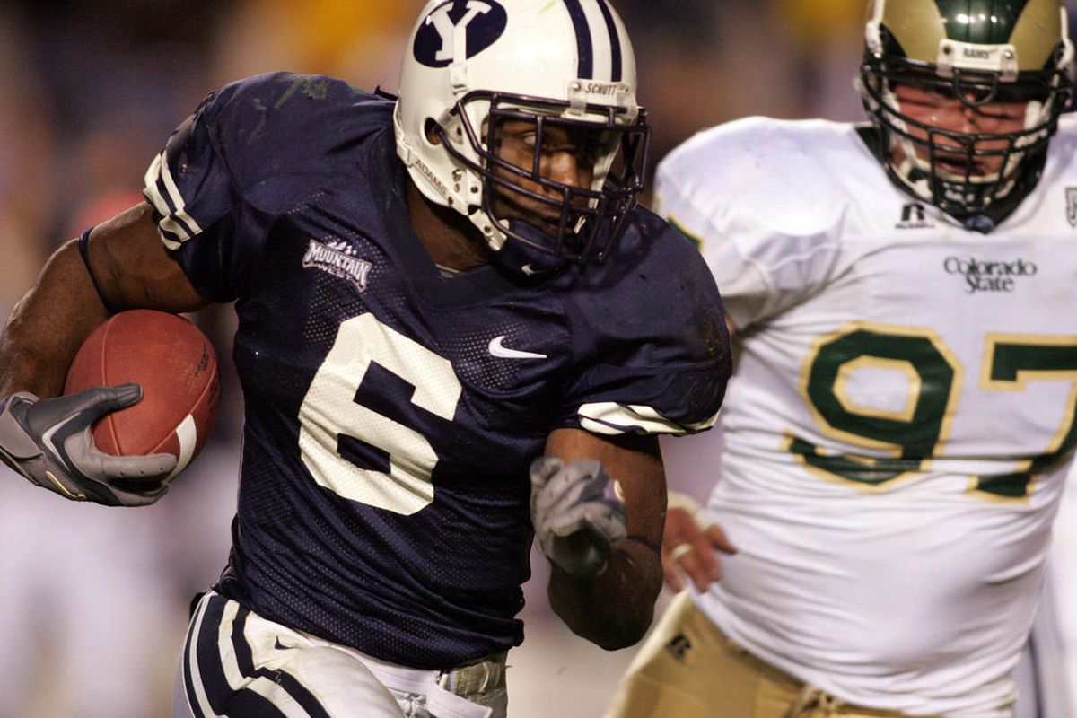 FILE: BYU Curtis Brown (6) runs past the pursuit of CSU's Blake Smith (97) as BYU faces CSU in Mountain West Conference football action at Lavell Edwards Stadium in Provo Saturday, October 15, 2005.