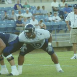BYU head football coach LaVell Edwards watches during a scrimmage in August 2000.