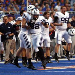BYU players cheer after holding Boise State on fourth down during NCAA football in Boise, Thursday, Sept. 20, 2012.