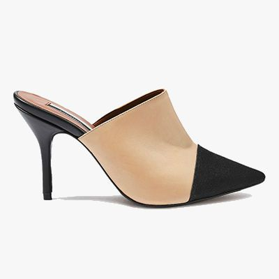 Peach and black colored thin heeled mule.