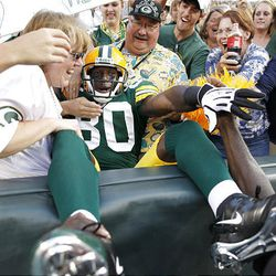 Green Bay Packers wide receiver Donald Driver (80) celebrates a first-quarter touchdown against the Cleveland Browns.