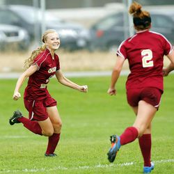 Maple Mountain's #13 Elise Flake, left, runs towards her teammates after scoring the team's second goal Tuesday, Sept. 25, 2012. Maple Mountain defeated Timpanogos 2-1.