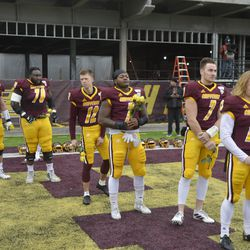 Senior players from the CMU football team await their turn to shake hands with the head coach.