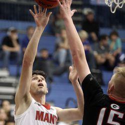 Manti's Konner Clark shoots over Grantsville's Davin Ekins during the 3A boys basketball state tournament quarterfinals at the Lifetime Activities Center in Taylorsville on Thursday, Feb. 20, 2020. Manti won 67-54.
