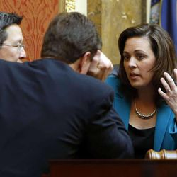 House Speaker Becky Lockhart, R-Provo, talks with Rep. Dean Sanpei, R-Provo, left, and Rep. Jim Dunnigan, R-Taylorsville, before the afternoon session in the House of Representatives begins at the Utah Capitol in Salt Lake City, Monday, Jan. 27, 2014.