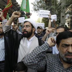 Iranian protestors chant slogans during a demonstration in front of the Swiss Embassy in Tehran, which represents US interests in Iran, Thursday, Sept. 13, 2012.