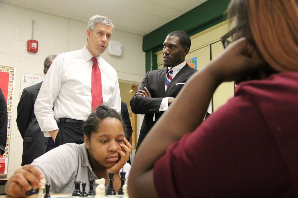 Principal Lionel Cable (right) speaks last fall with U.S. Education Secretary Arne Duncan during his visit last fall to Douglass K-8 school.