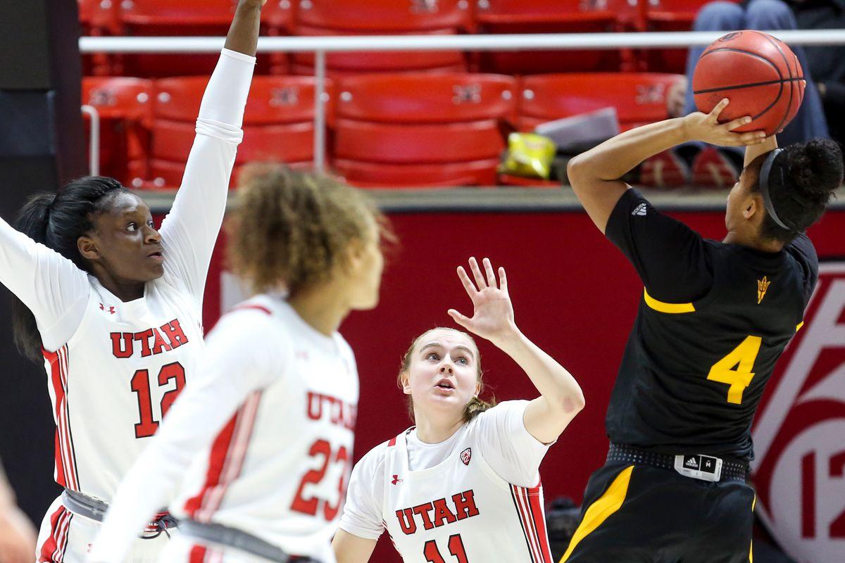 Arizona State Sun Devils guard Kiara Russell (4) goes for the basket against Utah Utes guard Brynna Maxwell (11) and forward Lola Pendande (12) Jon M. Huntsman Center in Salt Lake City on Sunday, Feb. 23, 2020.
