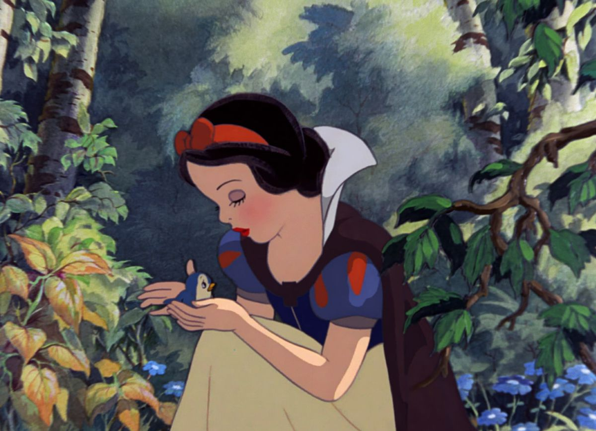 snow white cradles a bird in the woods