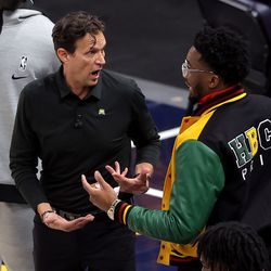 Utah Head Coach Quin Snyder and Utah Jazz guard Donovan Mitchell (45) talk as the Utah Jazz and the Memphis Grizzlies play in game one of their NBA playoff series at Vivint Arena in Salt Lake City on Sunday, May 23, 2021. Memphis won 112-109.