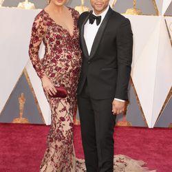 A pregnant Chrissy Teigen wears Marchesa alongside husband John Legend. Photo: Todd Williamson/Getty Images