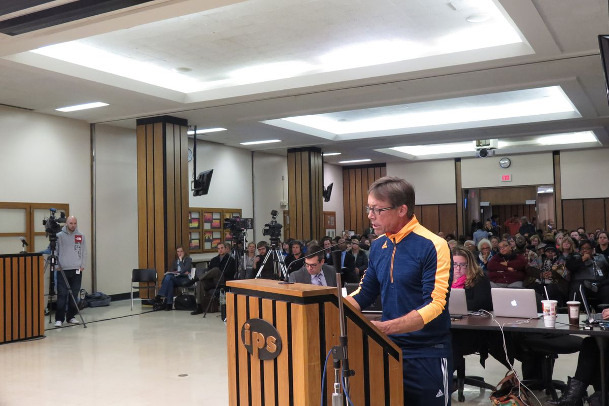 A parent speaks to the Indianapolis Public Schools board of education Tuesday night at a packed meeting on the future of Gambold Prep and Shortridge high schools.
