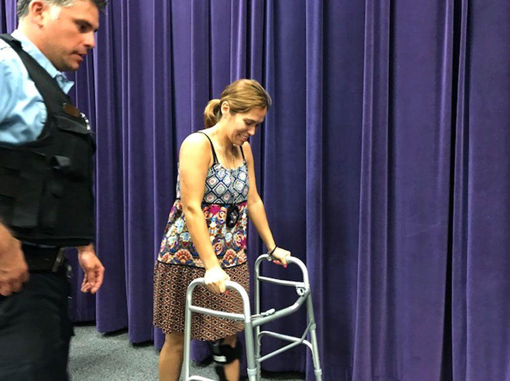 Chicago Patrol Officer Victoria Mendoza leaves a news conference Monday about police recruitment. Mendoza is recovering from a shattered kneecap suffered when she was shot in June while attempting to stop a robbery.| Fran Spielman/Sun-Times