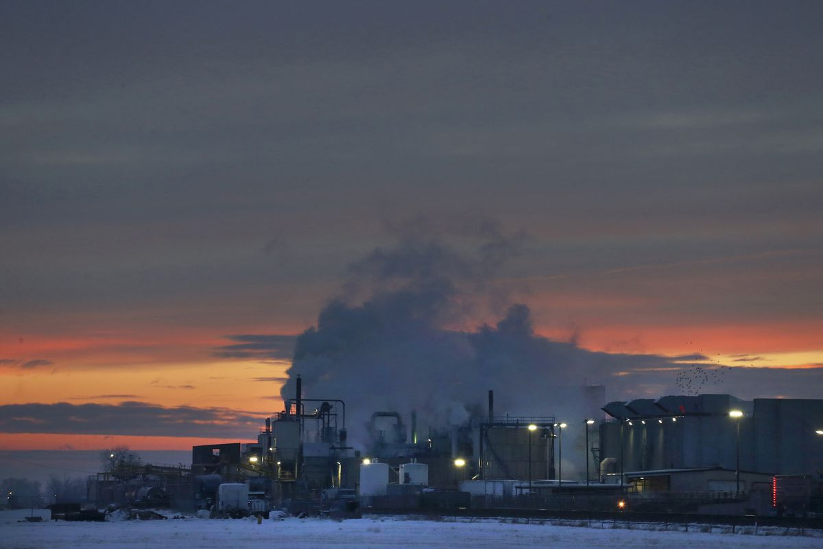 FILE - In this Jan. 11, 2016 file photo, dawn approaches over the meat processing plant owned and run by Cargill Meat Solutions, in Fort Morgan, a small town on the eastern plains of Colorado. The U.S. Equal Employment Commission said Friday, Sept. 14, 20