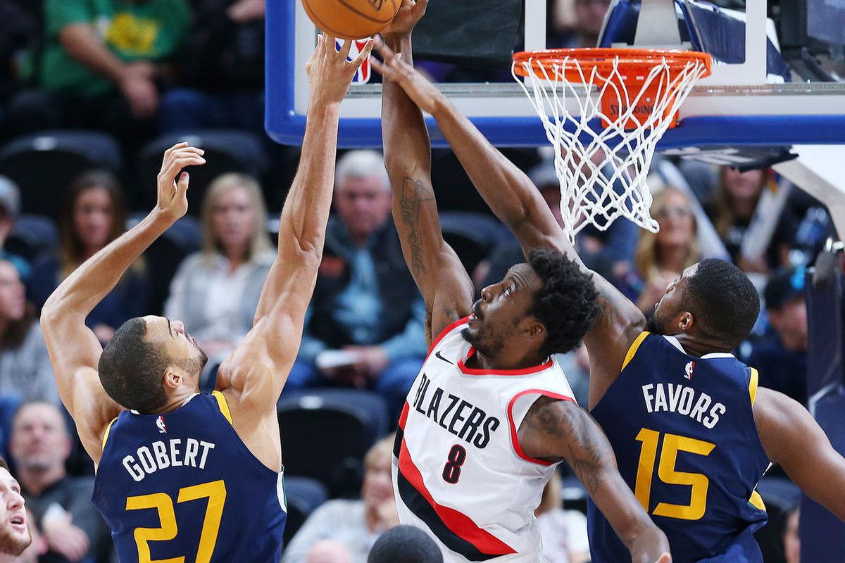 Utah Jazz center Rudy Gobert (27) and Utah Jazz forward Derrick Favors (15) battle Portland Trail Blazers forward Al-Farouq Aminu (8) for the ball as the Utah Jazz and the Portland Trailblazers play at Vivint Arena in Salt Lake City on Wednesday, Nov. 1,