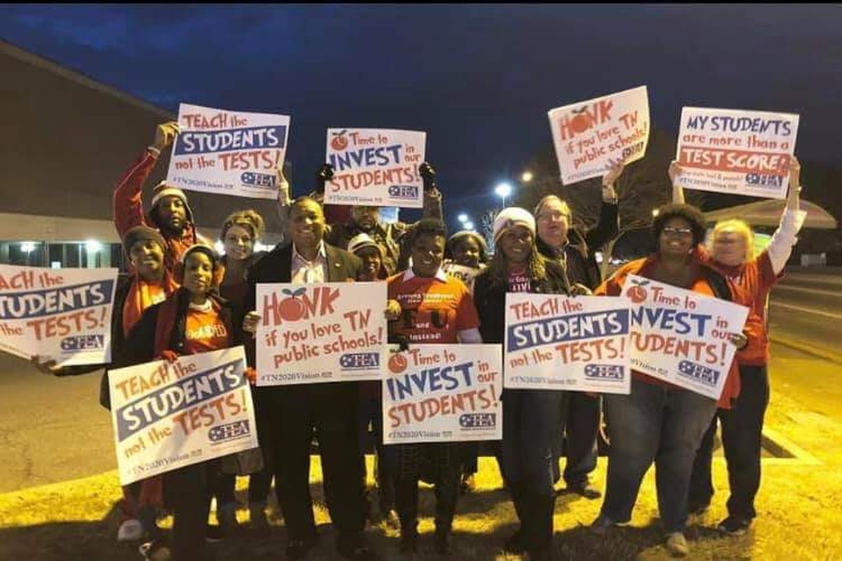 Members and supporters of the United Education Association of Shelby County are joined by interim superintendent Joris Ray in a #RedForEdDay of Action to raise awareness about inequities in public education earlier this month.