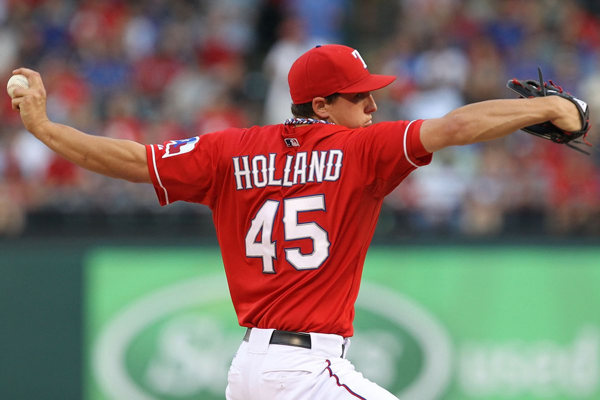 ARLINGTON, TX - MAY 07:  Pitcher Derek Holland #45 of the Texas Rangers throws against the New York Yankees in the first inning at Rangers Ballpark in Arlington on May 7, 2011 in Arlington, Texas.  (Photo by Ronald Martinez/Getty Images)