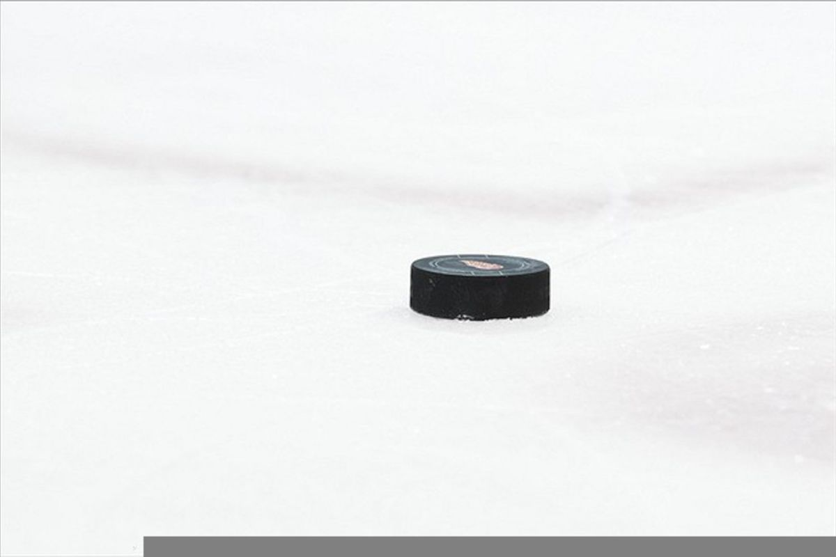 March 4, 2012; Detroit, MI, USA; Hockey puck on ice during the game between the Detroit Red Wings and the Chicago Blackhawks at Joe Louis Arena. Mandatory Credit: Rick Osentoski-US PRESSWIRE
