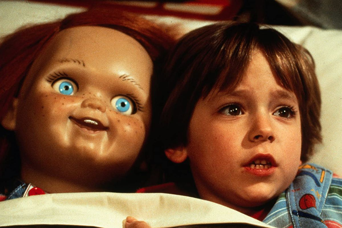 Andy (Alex Vincent) tucked into bed with Chucky