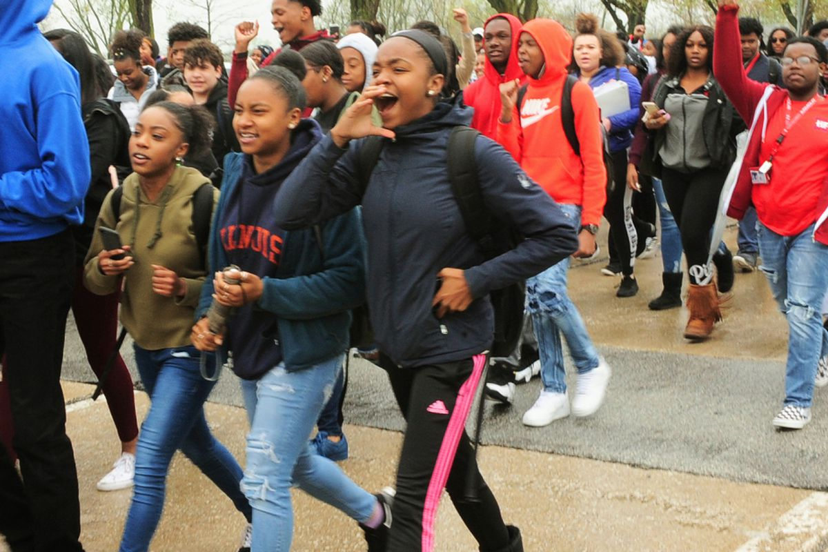 students walk out at homewood