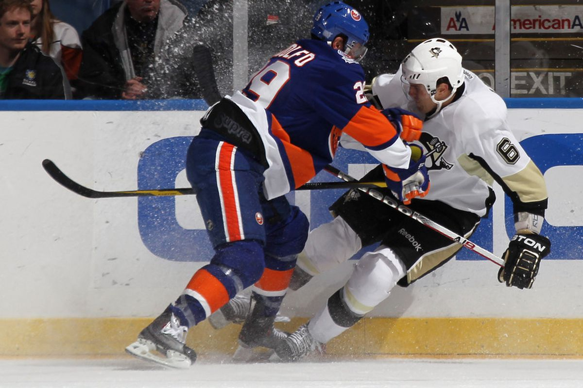 Jay Pandolfo of the New York Islanders checks Ben Lovejoy of the Pittsburgh Penguins at Nassau Veterans Memorial Coliseum on October 25, 2011 in Uniondale, New York. The Penguins shut out the Islanders 3-0. (Photo by Bruce Bennett/Getty Images)
