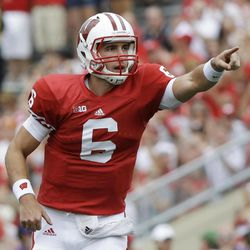 Wisconsin quarterback Danny O'Brien celebrates after throwing a touchdown pass to Jared Abbrederis during the first half of an NCAA college football game against Northern Iowa Saturday, Sept. 1, 2012, in Madison, Wis.