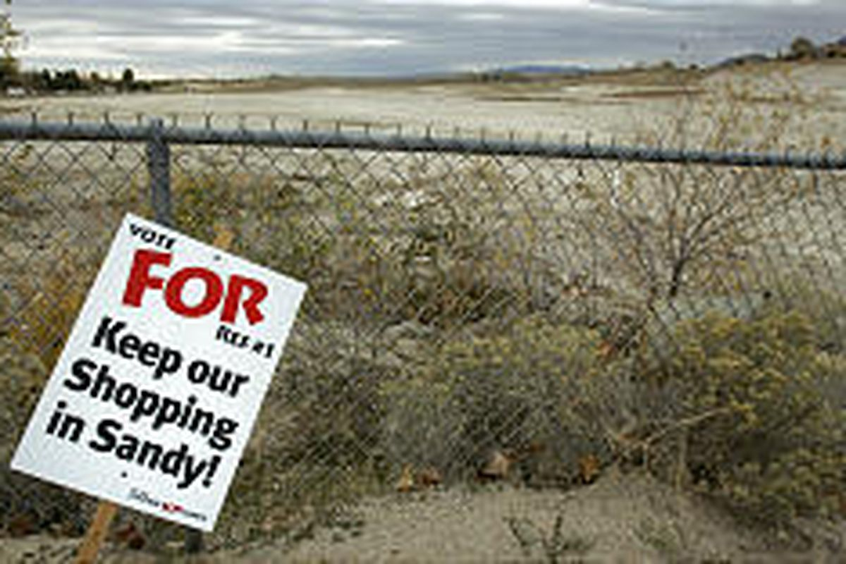 A sign urging voters to approve development in Sandy gravel pit stands outside area Tuesday. Measure passed 53 percent to 47 percent.