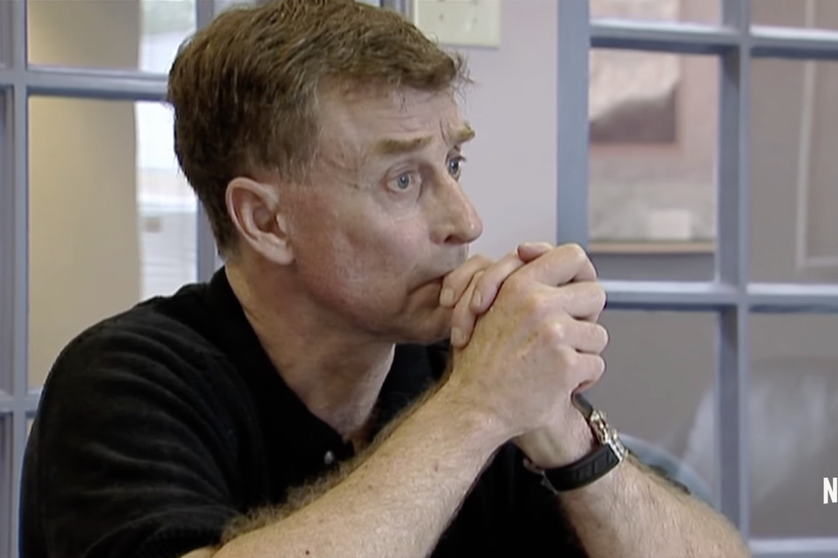Convicted murderer Michael Peterson with his hands clasped in front of his mouth