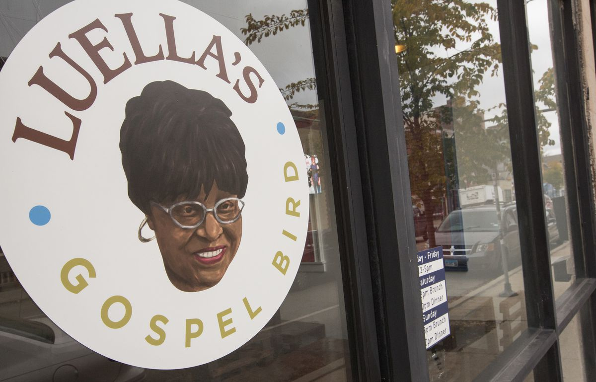 """A storefront window with a large sticker that reads """"Luella's Gospel Bird."""""""