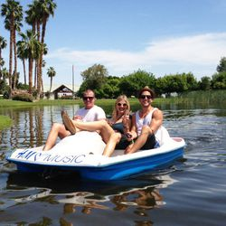 Happy paddle boat riders at Merv Griffin's stunning estate for H&M's first-ever Coachella pool party.