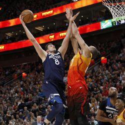 Minnesota Timberwolves' Nemanja Bjelica (8) shoots as Utah Jazz's Rudy Gobert (27) defends during the first half of an NBA basketball game Friday, March 2, 2018, in Salt Lake City. (AP Photo/Kim Raff)