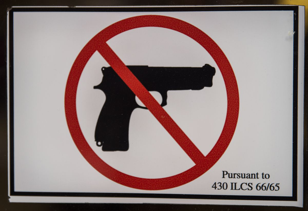 Gun-free zone sign on the door to City Hall in 2015.