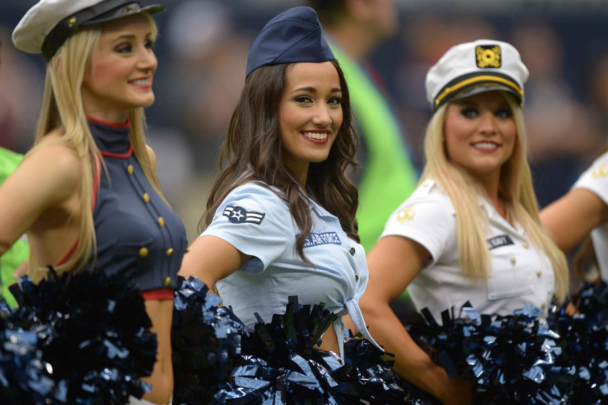 Houston Texans cheerleaders perform in military costumes as part of Salute to Service month festivities during the game against the Oakland Raiders at Reliant Stadium.
