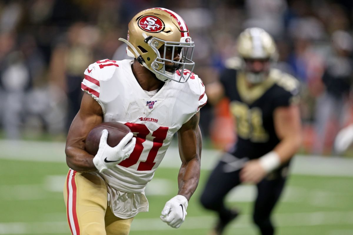San Francisco 49ers running back Raheem Mostert carries the ball against the New Orleans Saints in the second quarter at the Mercedes-Benz Superdome.