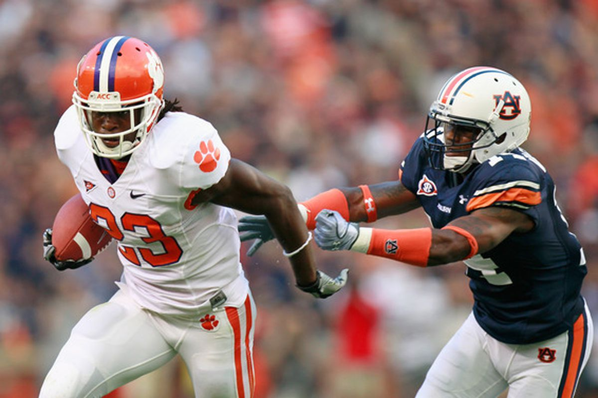 AUBURN AL - SEPTEMBER 18:  Andre Ellington #23 of the Clemson Tigers breaks a tackle by Demond Washington #14 of the Auburn Tigers at Jordan-Hare Stadium on September 18 2010 in Auburn Alabama.  (Photo by Kevin C. Cox/Getty Images)