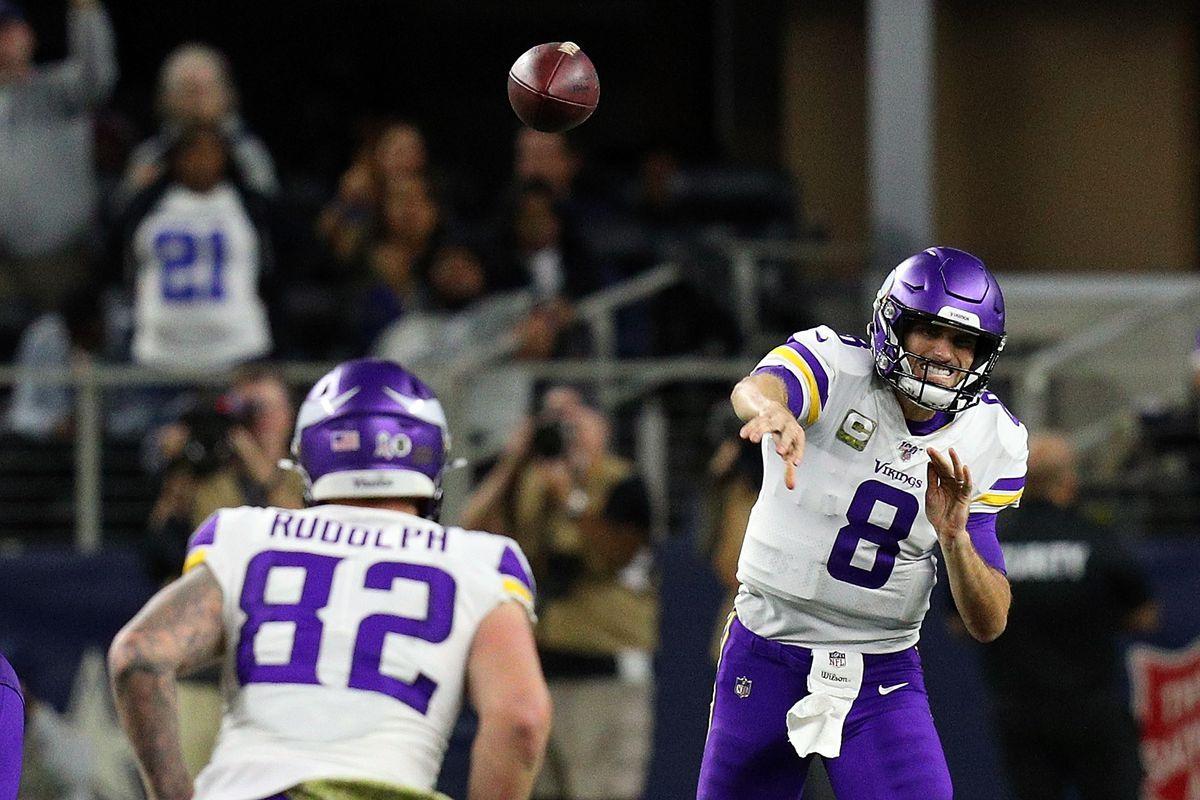 Kirk Cousins of the Minnesota Vikings passes to Kyle Rudolph of the Minnesota Vikings in the fourth quarter against the Dallas Cowboys at AT&T Stadium on November 10, 2019 in Arlington, Texas.