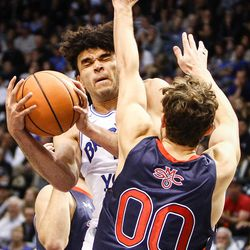 Brigham Young Cougars guard Elijah Bryant (3) closes his eyes as he puts up a shot against St. Mary's Gaels guard Tanner Krebs (00) as the BYU Cougars take on the Saint Mary's Gaels in the Marriott Center in Provo on Saturday, Dec. 30, 2017.
